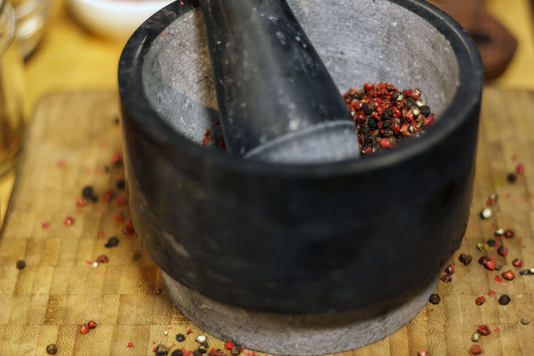 Pestle and mortar with mix peppercorn Indoors  Food No People Close-up Mortar And Pestle Table Healthy Eating Container Spice Pile Peppercorns Pink Pepper Red Peppers Black Peppercorn Seed Crush Bowl Exotic Flavor Preparation  Grind Utensils Ingredient Tool Pepper
