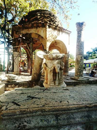 Statue Sculpture Art And Craft History Architecture Art Built Structure Tree Old Ruin Travel Destinations The Past Ruined Ancient Damaged Stone Material Famous Place Memories Creativity Greek Greece Architectural Feature Sunlight Tree Tranquility Tranquil Scene
