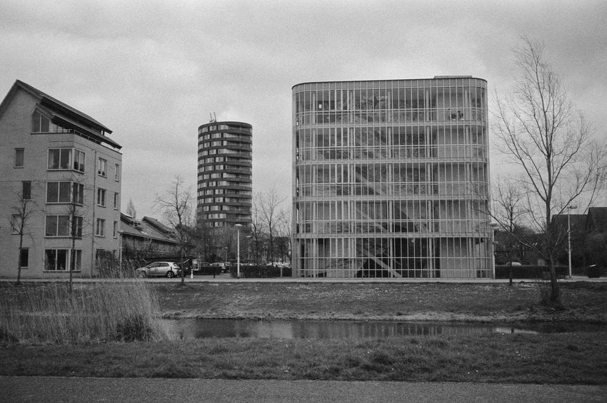Buildings in Utrecht 35mm 35mm Film Analog Architecture Black & White Blackandwhite Building City Film Glass Grass Ilford HP5 Plus Modern Reflection Rodinal Stairs Street Tall Tower Tree Urban Water