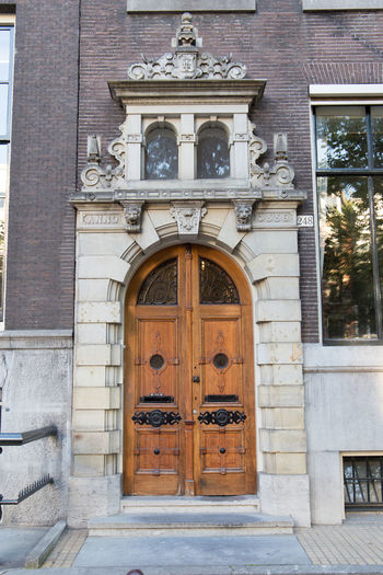 Amsterdam Netherlands Arch Architectural Column Architecture Art And Craft Building Building Exterior Built Structure Closed Craft Day Door Dutch Architecture Dutch Houses Entrance History Holland House No People Ornate Outdoors Protection Safety Security The Past Wood - Material
