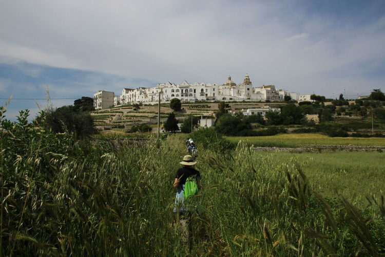 Walking to Locorotondo Hiking Locorotondo Puglia Walking Around Adult Ancient Civilization Architecture Building Exterior Cloud - Sky Day Field Grass Growth History Men Nature One Person Only Men Outdoors People Sky Travel Destinations Walking Young Adult