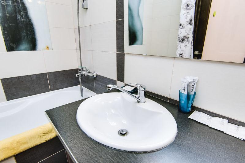 Bathroom Domestic Bathroom Faucet Sink Hygiene Home Mirror Bathroom Sink Domestic Room Indoors  Household Equipment Flooring Tile Reflection Wash Bowl No People Soap Dispenser Home Interior Towel Modern Purity Luxury