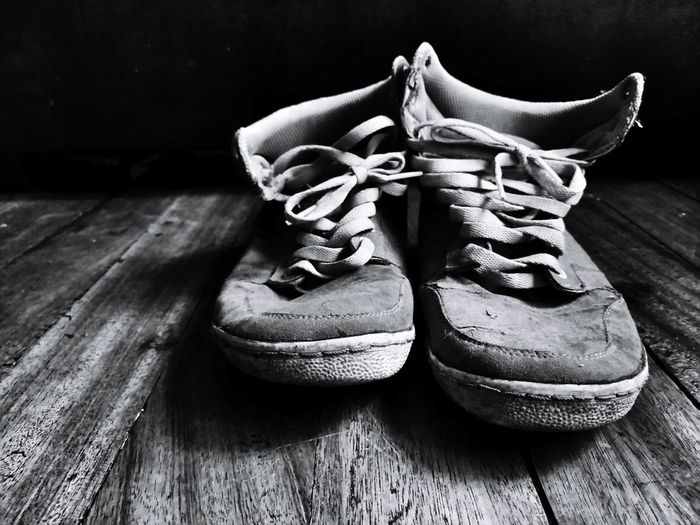Close-up of shoes on wood