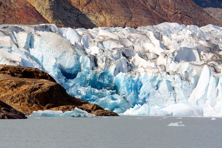 Snow covered glaciers melting