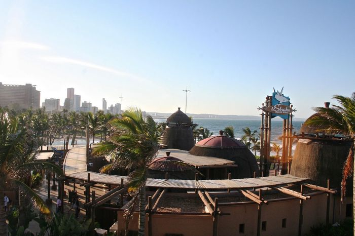 Ushaka marine world- Durban Architecture Blue Building Exterior Built Structure City Clear Sky Copy Space Day Growth House No People Outdoors Plant Residential Building Residential District Residential Structure Roof Sky Sunlight Theme Park Travel Photography Tree Ushaka Marine World