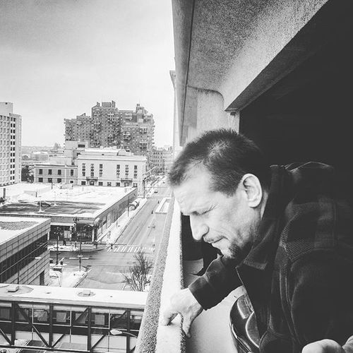Cool shot of my Dad taking a look off the parking garage at Rochester Riverside Convention Center last year during the annual car show. Roctopshots Thisisroc Rochesterny  Blackandwhite Explore Vscocam Snapseed IPhoneography Winter Dad Positivity Family CarShow Pixelpanda Citylife