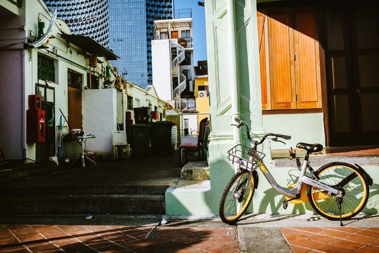 Bicycles on sidewalk by building in city