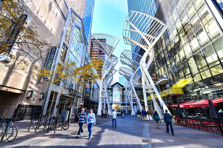 Pedestrians walking past retail outlets along Stephen Ave in Autumn, Calgary, Alberta. Stephen Ave is a famous pedestrian mall in downtown Calgary Calgary Canada Stephen Ave Adult Adults Only Architecture Building Exterior Built Structure City City Life Cityscape Crowd Day Modern Outdoors Panoramic People Real People Sky Skyscraper Stephen Avenue Travel Destinations Walking Walkway