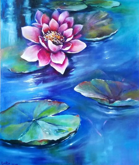 Close-up of blue water lily in swimming pool