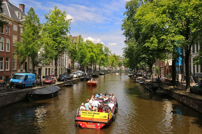 Amsterdam Canal Amsterdamthroughmycamera Taking Photos Brick Building Water Water Reflections Boats Trees And Sky Clouds Bridge Bridge View Gable Houses