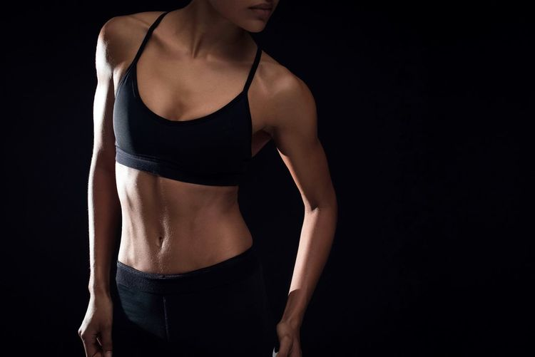 Black Background Healthy Lifestyle Exercising Studio Shot Strength Lifestyles Muscular Build Athlete Sport One Person Sports Training Flexing Muscles Self Improvement Human Abdomen Adult People Girl Woman Woman Of EyeEm Fit Fitness
