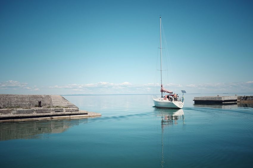 Leaving harbour, Borghamn, Sweden. Nautical Vessel Transportation Water Mode Of Transport Day Nature Outdoors Blue Tranquility Scenics Sky Moored Beauty In Nature Two People Clear Sky Sea Mast