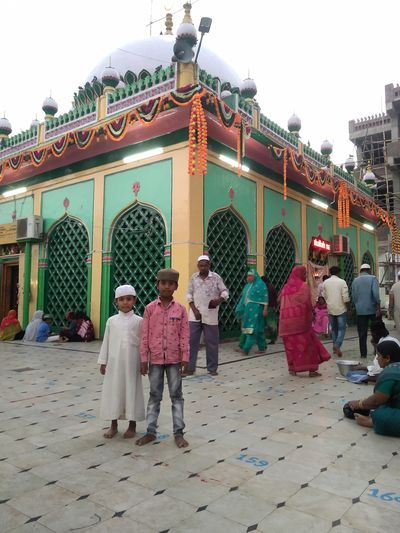 Group of people outside temple against building