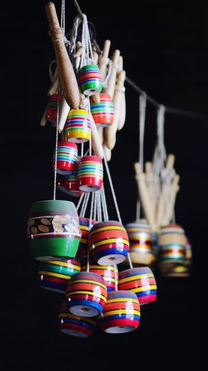 Handmade toys Hanging Multi Colored Variation Choice Large Group Of Objects Black Background Collection Indoors  Group Of Objects No People Close-up
