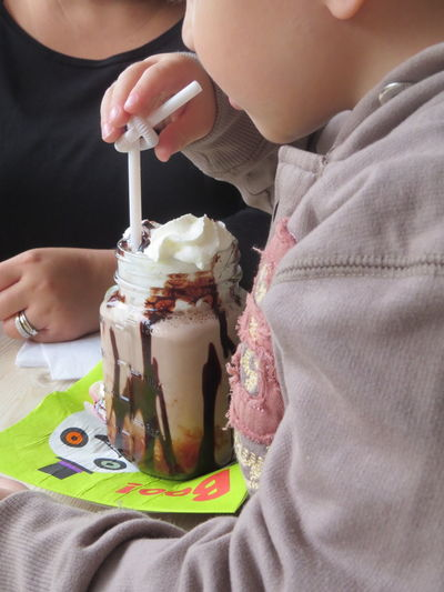 enjoying an ice cream on a day out Cafe Time Childhood Day Day Out With Family Ice Cream Indoors  Real People Straw
