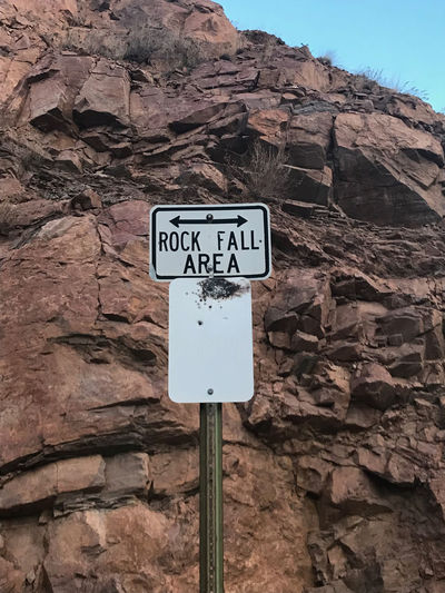 Close-up Communication Day Guidance Mountain Nature No People Outdoors Placard Road Sign Rock - Object Signboard Text