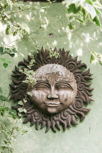 Architectural Feature Art Art And Craft Carving - Craft Product Close-up Creativity Culture Day Design Green Color History Human Representation Idol Outdoors Philippines Place Of Worship Representation Sculpture Statue Sun Wood - Material