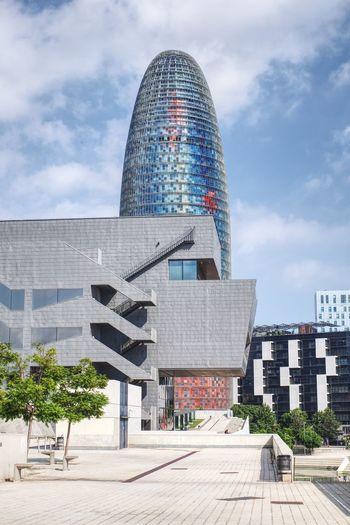 Architecture Modern Building Exterior Built Structure Tower Skyscraper Sky City Cloud - Sky Travel Destinations Day Futuristic Outdoors Dome No People Cityscape Barcelona Torreagbar