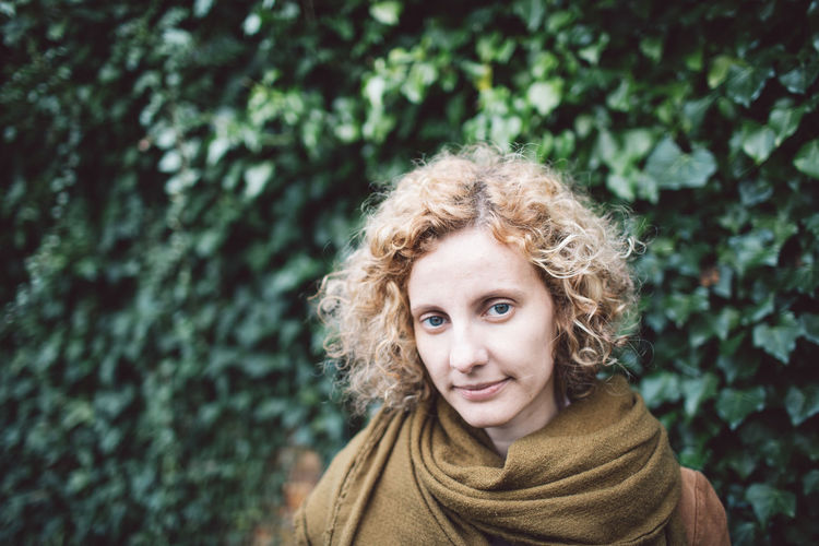 Curly Hair Girl Portrait Looking At Camera One Person Blond Hair Headshot Hair Smiling Women Front View Day Plant Nature Emotion Green Color Happiness Leisure Activity Tree Hairstyle Outdoors Scarf Warm Clothing Human Hair The Portraitist - 2019 EyeEm Awards