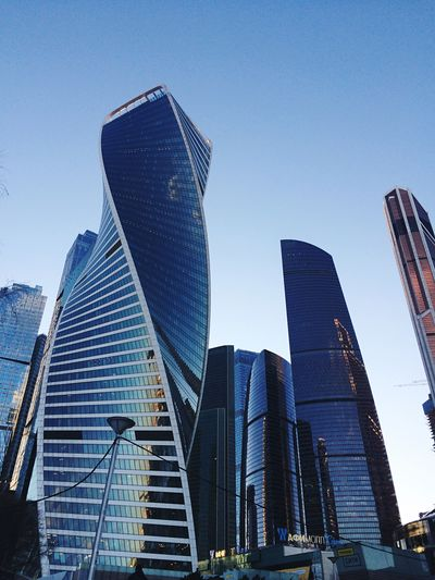 Moscow Architecture Cityscape Building Exterior Built Structure Architecture Office Building Exterior Sky Skyscraper City Building Tall - High Office No People Clear Sky Blue Low Angle View Travel Destinations Day