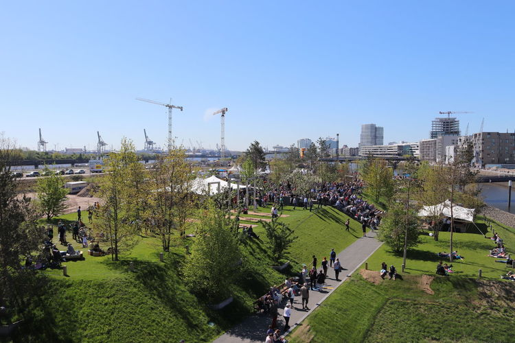 Eröffnung Baakenpark Hafencity Hamburg Opening Day Architecture Baakenhafen Baakenpark Building Building Exterior Built Structure City Clear Sky Copy Space Day Grass Group Of People Incidental People Mode Of Transportation Nature Opening Outdoors Park Plant Road Sky Sunlight Tree