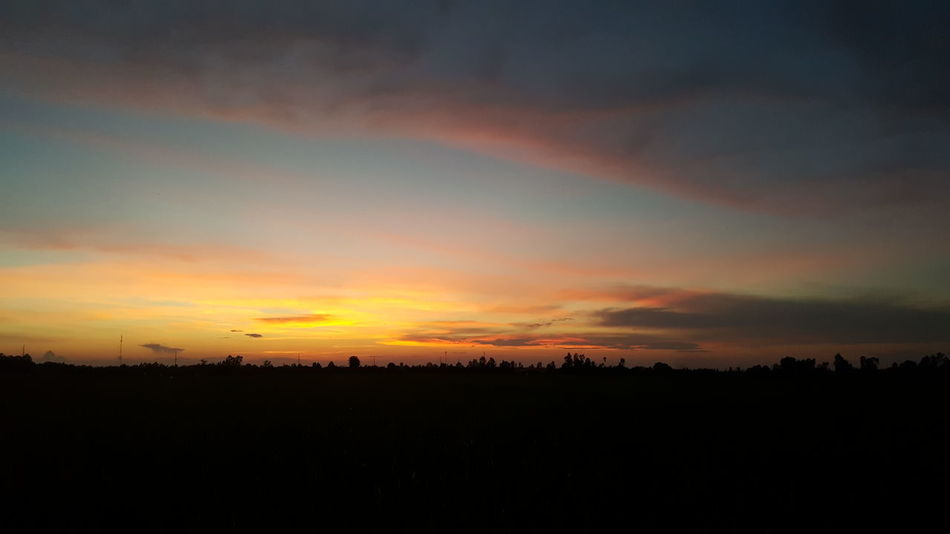 Sunset in my village, behind my house Sunset Silhouette Nature Sky Dramatic Sky Beauty In Nature Cloud - Sky Scenics Cloudscape Tranquility Outdoors Tree No People