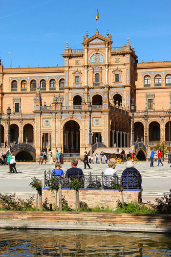 Place de Espana, Sevilla Adult Ancient Civilization Arch Architectural Column Architecture Building Exterior Built Structure City Clear Sky Day History Large Group Of People Leisure Activity Lifestyles Men Outdoors Real People Sky Sunlight Tourism Travel Travel Destinations Vacations Water Women