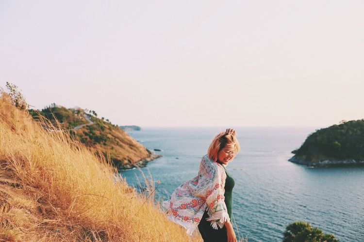 Nature Sea Horizon Over Water Real People One Person Leisure Activity Beauty In Nature Travel Sky Sunset Smile Asain Asaingirls Young Women Outdoors Blond Hair