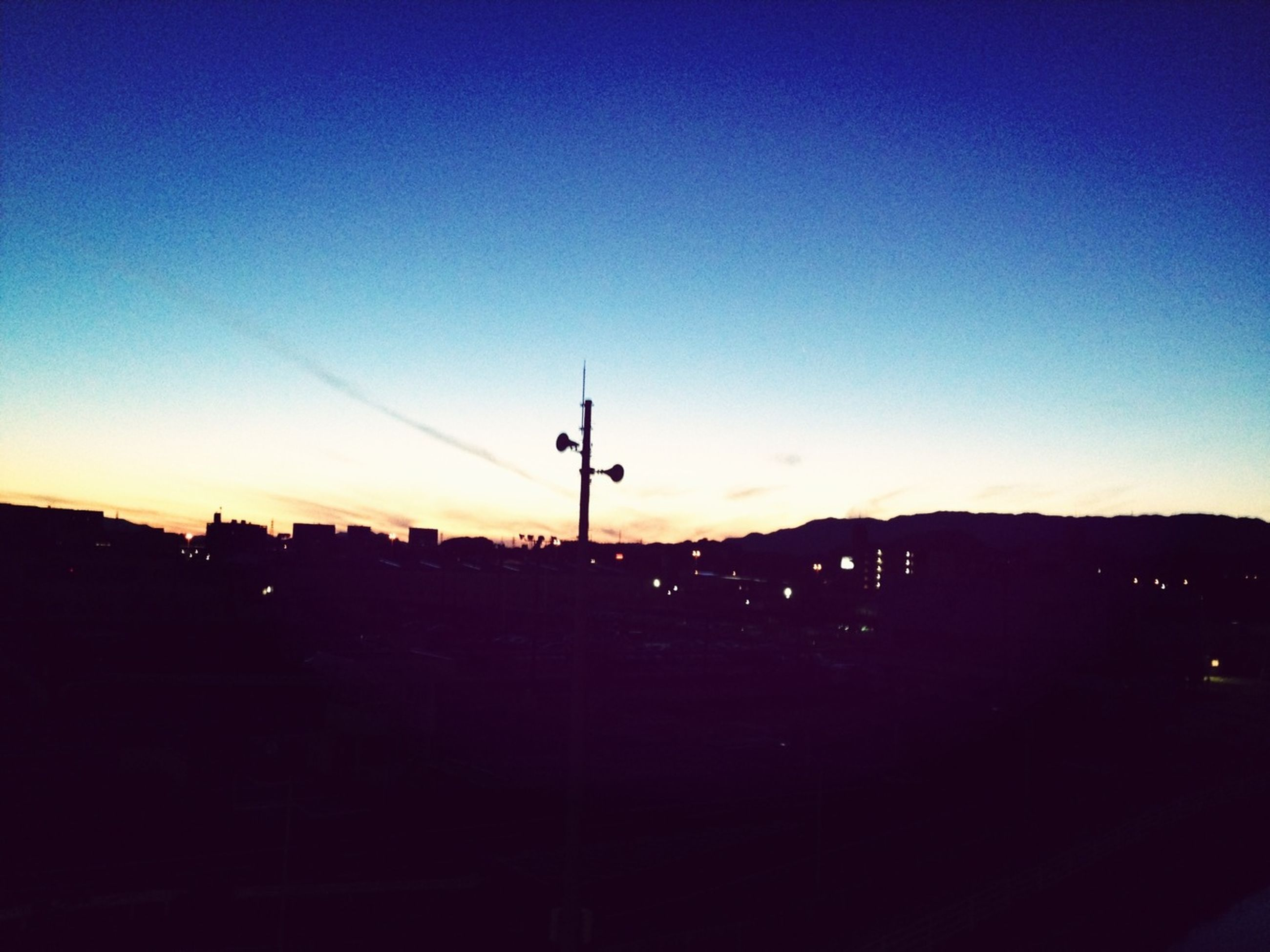 silhouette, sunset, building exterior, built structure, copy space, architecture, blue, clear sky, dusk, sky, street light, dark, outdoors, city, no people, orange color, communications tower, outline, nature, house