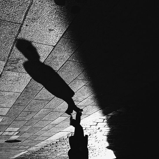1620 Shadow Real People Silhouette Sunlight Focus On Shadow Lifestyles Leisure Activity One Person Balance High Angle View Outdoors Day Skill  Flexibility Handstand  Full Length People Streetphotography Minimalism EyeEmNewHere Monochrome Blackandwhite EyeEm Best Shots - Black + White EyeEm Best Shots