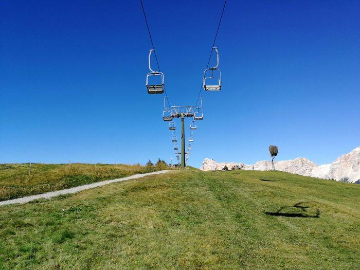 Technology Ski Lift Cable Blue Electricity  Overhead Cable Car Sky Grass Landscape