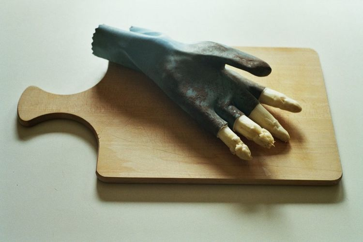 the thief Art Foto Composition Fine Art Photography Ulli Predeek Art Asparagus Close-up Cutting Board Damaged Day Glove High Angle View Indoors  Iogetherness Mystery No People Photo Art Riddle Rubber Gloves Still Life Surreal Surrealism Table White Background Wood - Material