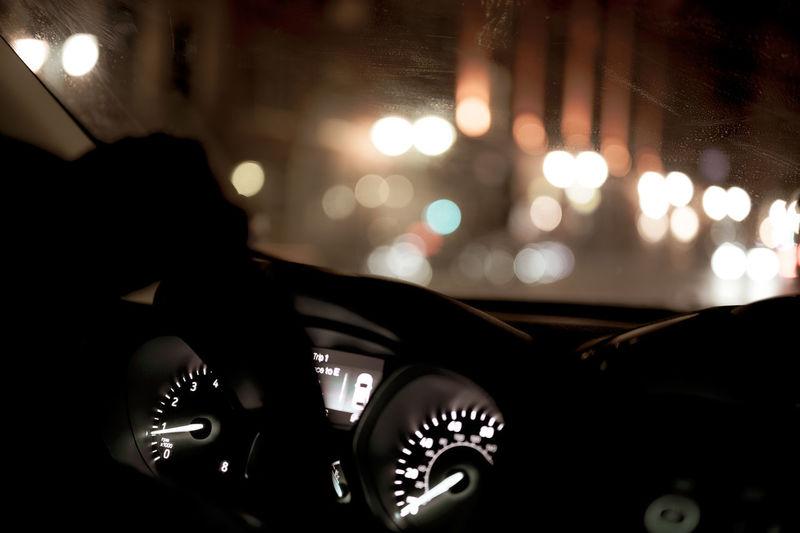 Close-up of illuminated lighting equipment in car