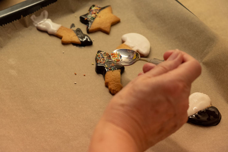 High angle view of person hand on table