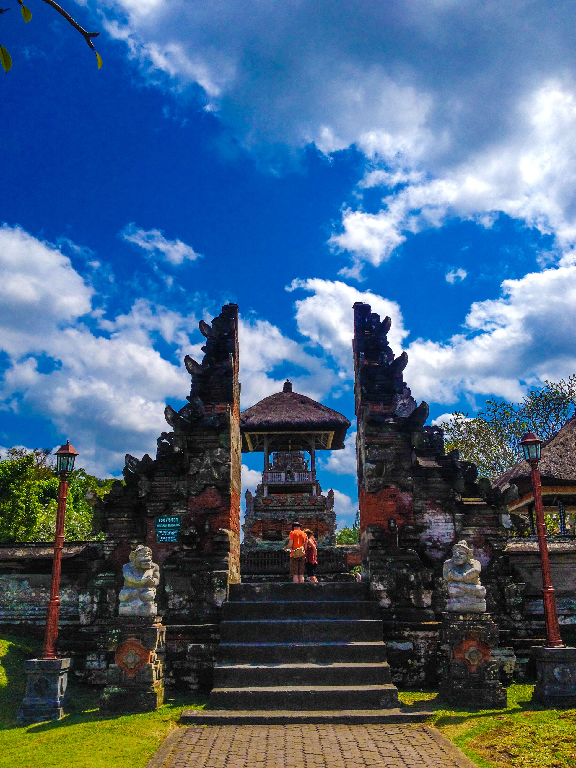 architecture, built structure, sky, building exterior, low angle view, place of worship, religion, cloud - sky, spirituality, steps, temple - building, tree, cloud, history, blue, outdoors, entrance, steps and staircases