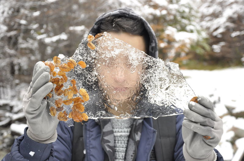 Close-Up Of Woman Holding Ice