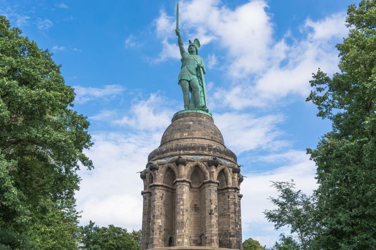 Statue of Cheruscan Arminius in the Teutoburg Forest near the city of Detmold, Germany. Architectural Column Architecture Art And Craft Built Structure Cloud - Sky Creativity Day Government History Human Representation Low Angle View Memorial Nature No People Plant Representation Sculpture Sky Statue Travel Travel Destinations Tree