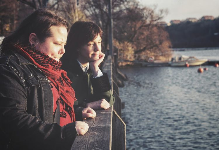 Lesbian couple looking at lake