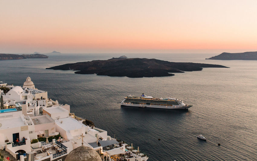 High Angle View Of Cruise Ship In Sea During Sunset