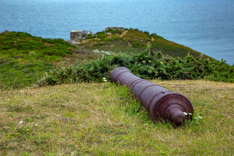 English Channel Eperquerie Isle Of Sark Beauty In Nature Cannon Canon Day Grass History Island Nature No People Outdoors Sark Scenics Sea Tranquility Water Weapon