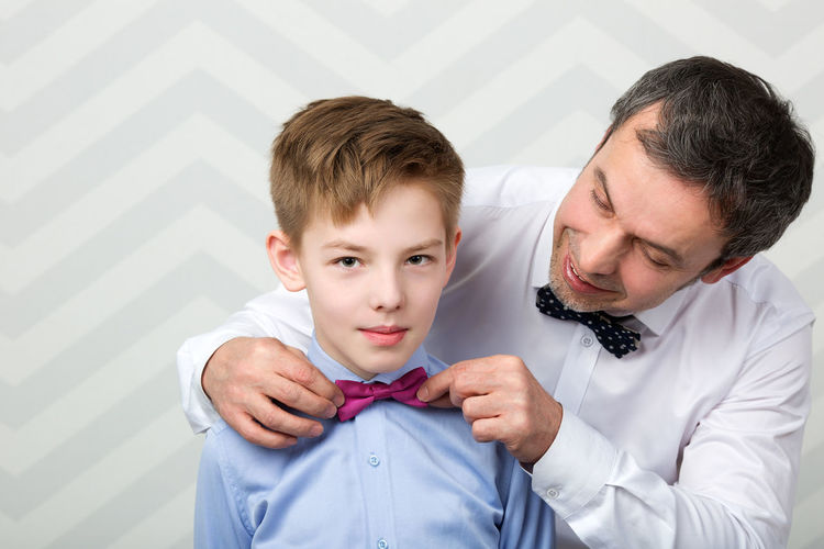 Adjust Bow-tie Bowtie Boy Caucasian Celebrate Ceremony Dad Daddy Event Family Father Formal Help Horizontal Kid Male Man Parent Son Two