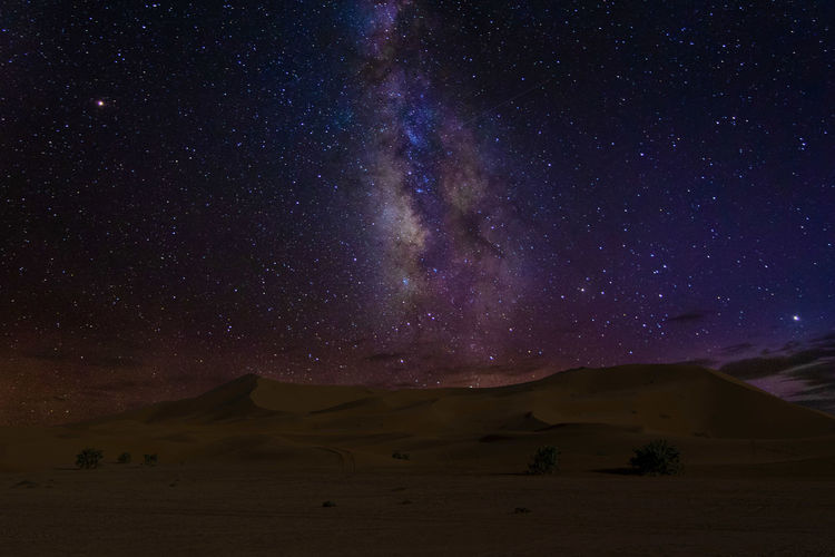 Night full of star in morocco desert Astronomy Galaxy Milky Way Star - Space Mountain Space Constellation Moon Sky Landscape Space And Astronomy Volcanic Landscape Desert Infinity Arid Sand Dune Astrology Arid Climate Starry Emission Nebula Star Trail First Eyeem Photo