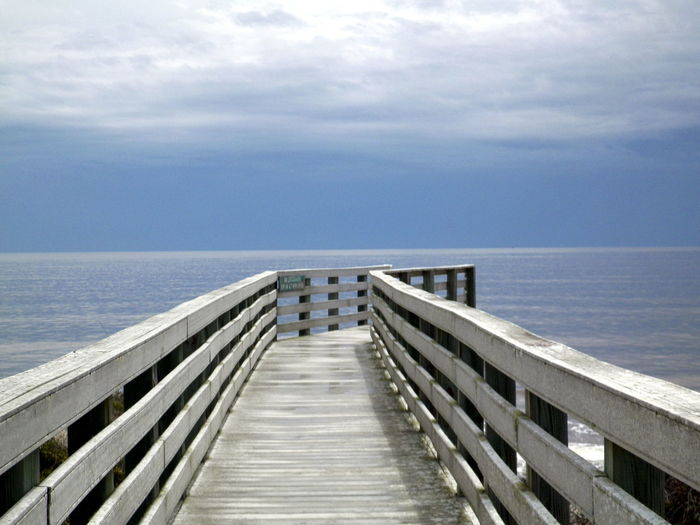 View of pier on calm blue sea