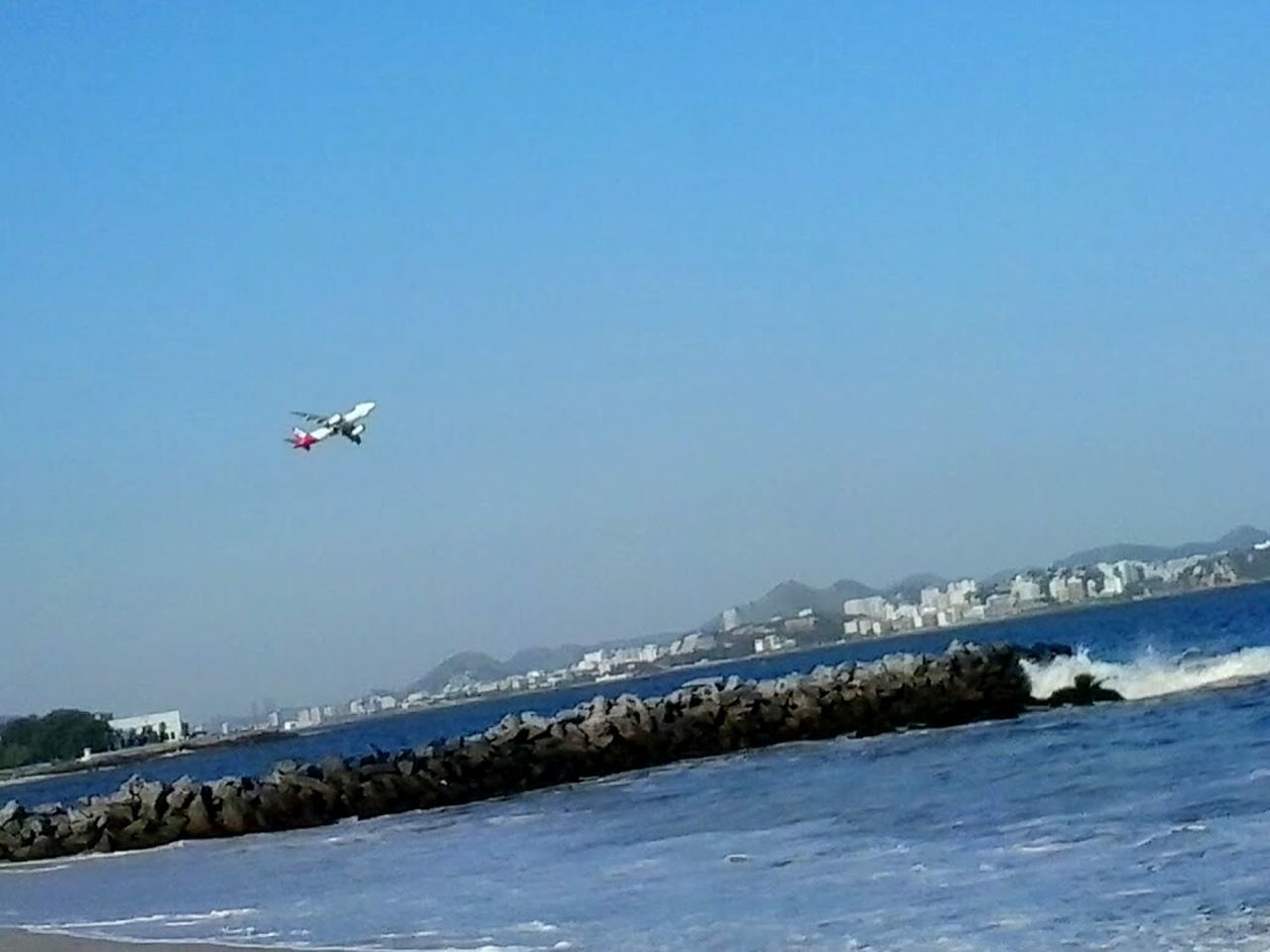 flying, mid-air, motion, nature, day, outdoors, water, airplane, blue, clear sky, sky, mountain, no people, beauty in nature, cold temperature, snow, scenics, sea
