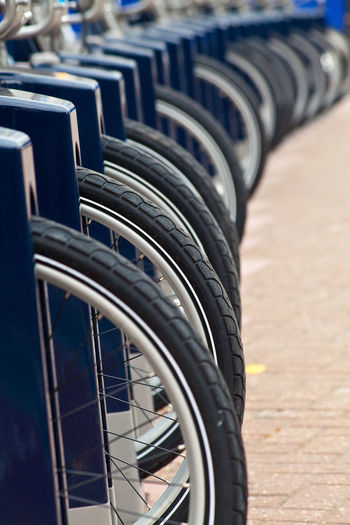 Close-up of bicycle tires in row