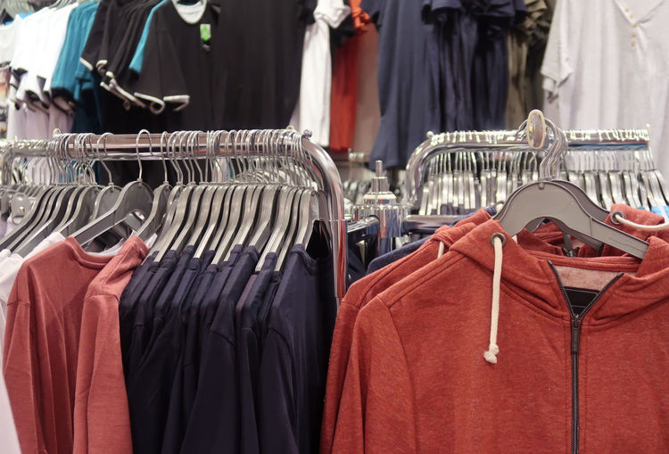 Clothes hanging for sale at store