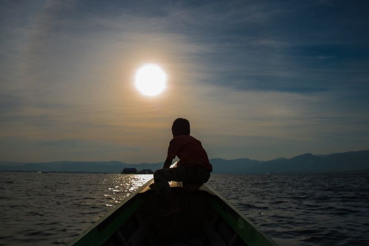 Find my way Inle Lake Myanmar Boy On Boat Water Sky Beauty In Nature Real People Sea Sunset Scenics - Nature Cloud - Sky One Person Nature Rear View Lifestyles Leisure Activity Idyllic Outdoors