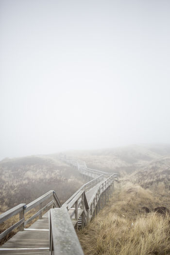 Beauty In Nature Day Fog Foggy Grass Island Landscape Landscape_Collection Misty Nature No People Northsea Outdoors Railing Sand Dune Scenics Seaside The Way Forward Tranquility