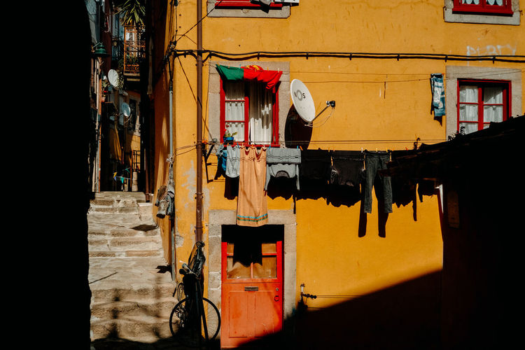 Clothes drying on clothesline amidst buildings in city