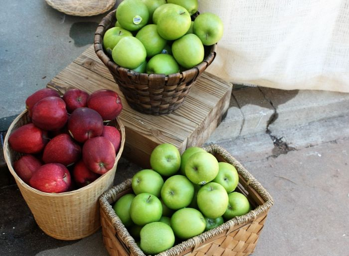 High Angle View Of Apples In Baskets For Sale At Street Market